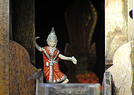 Small thai dancer keeps the spirit house occupied